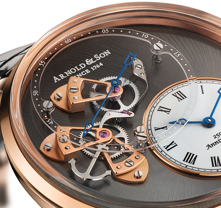 Detail of the deadbeat seconds dial, in sapphire, with three gold bridges