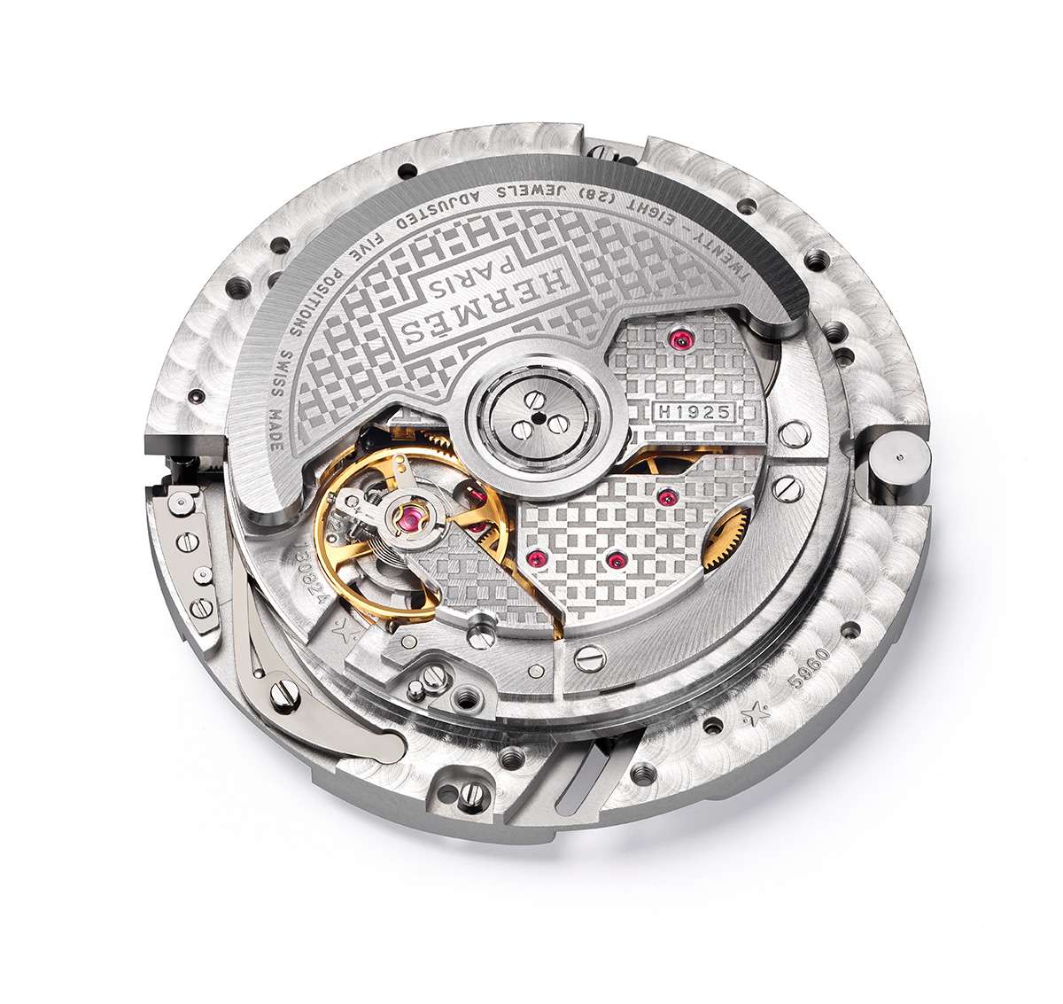 The H1925 movement, the oscillating weight with Hermès' own decorative pattern
