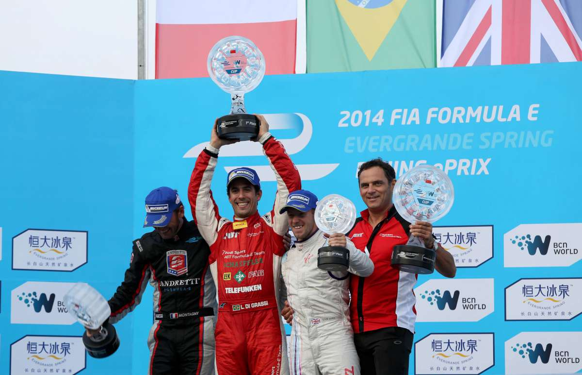 Lucas di Grassi, winner of the first FormulaE race in Beijing, with Franck Montagny and Sam Bird, and the trophy created by de Grisogono
