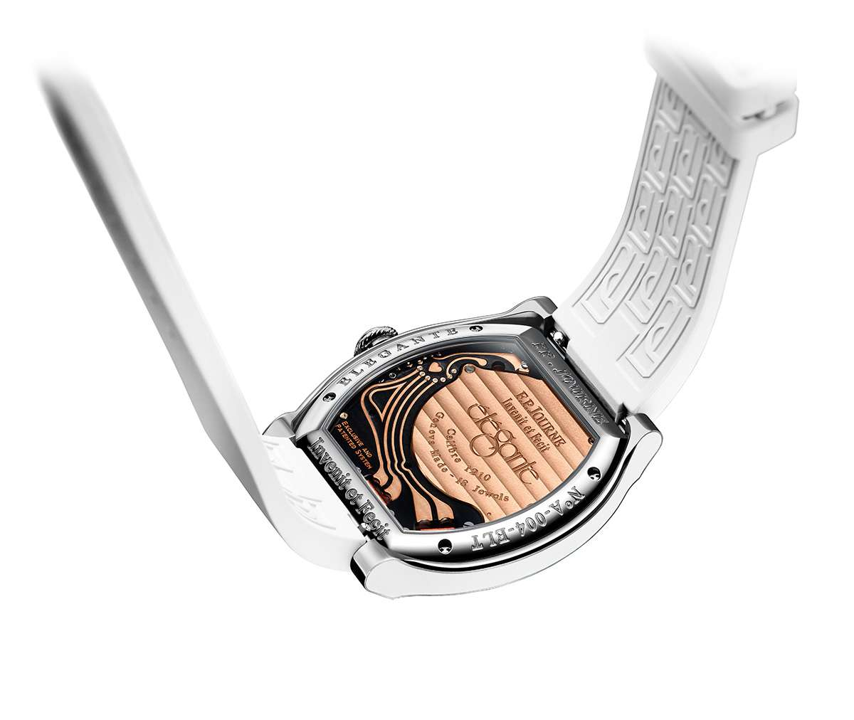 Caseback showing the battery bridge with Cotes de Genève decoration, the heart-shape denoting the microprocessor, and the circuitry
