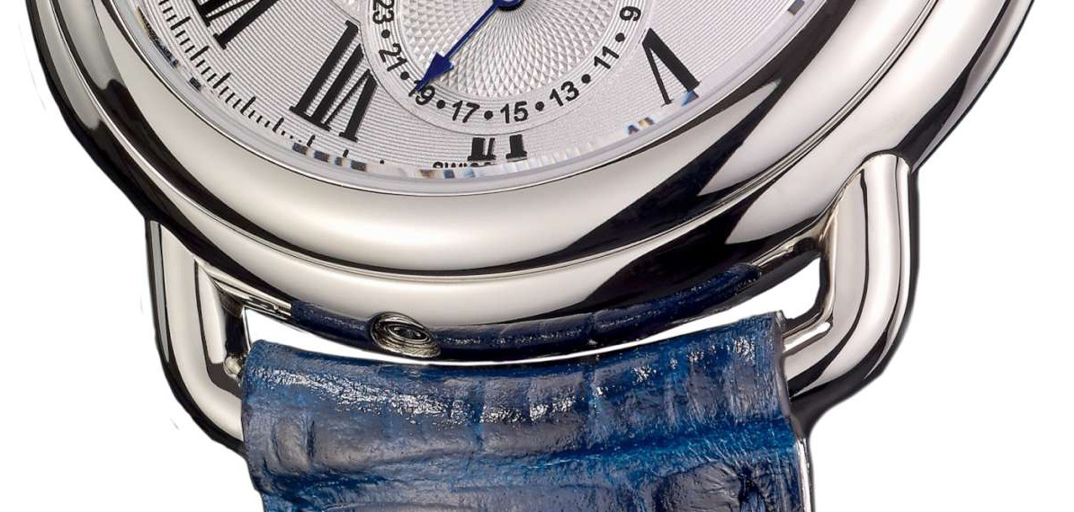 Detail of the bottom loop, with the recessed date correction button
