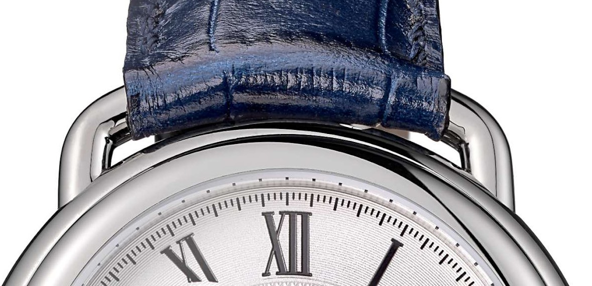 Detail of the top strap loop-type lug, with, at about 2 minutes past 12, the recessed moon phase corrector.