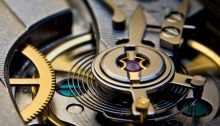 Balance wheel with regulator and beat corrector